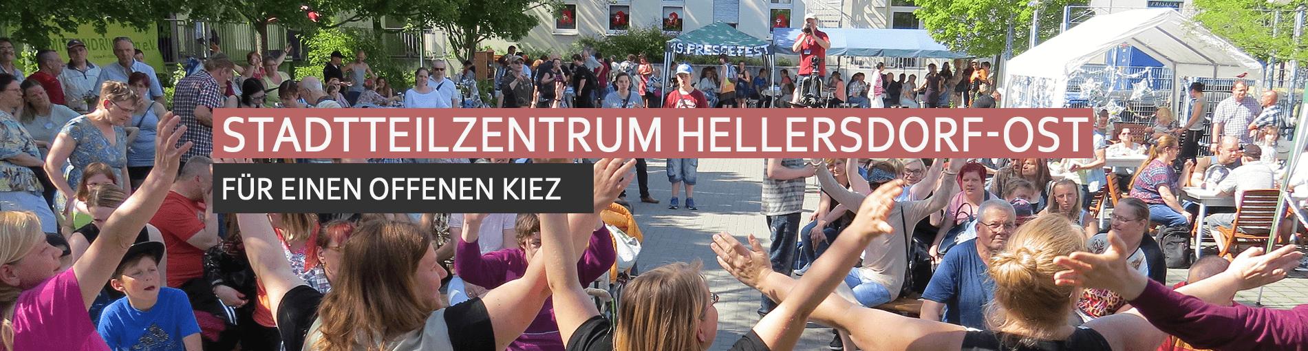 Titelbild Stadtteilzentrum Hellersdorf-Ost - Menschen feiern auf dem Hinterhof das Pressefest